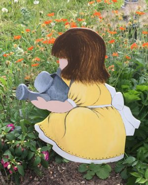 Trädgårds rumpa flickan